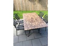 Excellent heavy tiled top garden table with 4 steel chairs