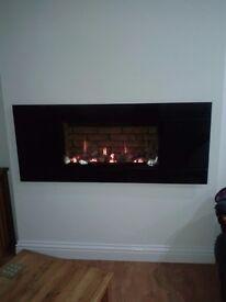 Gazco studio slimline gas fire comes with black glass panel