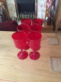 Six red plastic wine glasses
