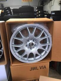 Alloy wheels with new tyres