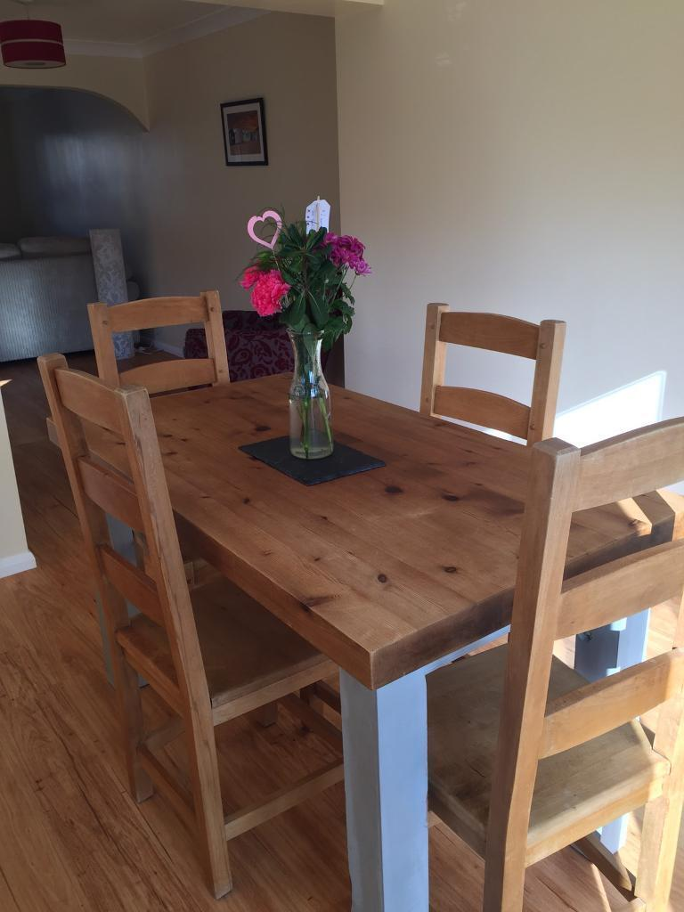 Wooden Dining Table And Four Chairs In Excellent Condition