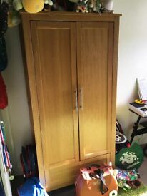 Oak furniture set, immaculate condition wardrobe with 2 rails and 3, 3 drawer unit and cot bed