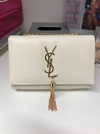 YSL cream clutch bag