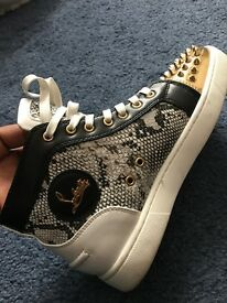 Christian Louboutin snake skin leather spikes