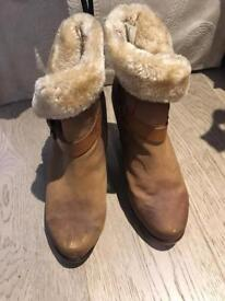 fur lined stack high heeled boots