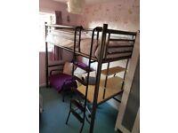 Metal high sleeper bed.