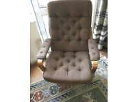 Retro 1980's reclining swivel chair in orange and brown fabric.