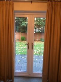 2 sets of pale gold curtains