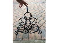 Black wrought iron wine rack
