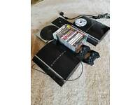 2 x PS3 with 18 games and 2 controllers