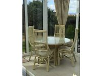 Round dining table & 4 matching chairs with cushions, good for conservatory or kitchen/diner