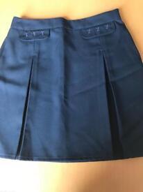 Brand new M&S Navy school skirt Age 8-9