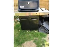 Weber spirit premium 320 gas BBQ with brand new cast iron griddle and cover