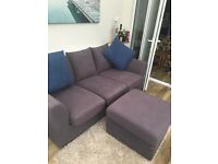Grey sofa with scatter cushions with foot stool