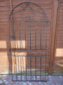 Tall metal garden gate with hinge mounts and clasp mount
