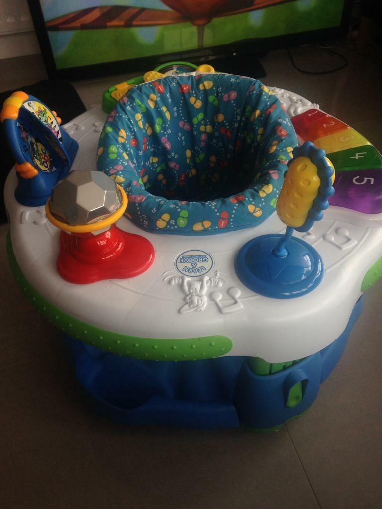 "Leap Frog ""learn and groove"" bouncer. Like a Jumparoo"