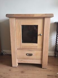Solid oak side cabinet with glass door.