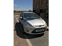 ford fiesta 3 door silver 2010 with full black leather seats not even done 60000 miles