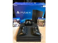 PS4 PRO 1TB WITH TWO CONTROLLERS TWO GAMES FIFA 18 and CALL OF DUTY WWII
