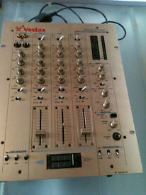 Vestax pmc-270A professional mixing controller (large light coloured one in picture)