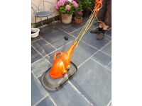 Flymo mini mo lawnmower, ideal for small garden.