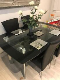 Metal And Glass Boat Dining Table