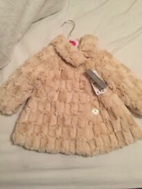 Brand new faux fur coat, still with tags, size 6-9 months