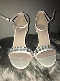 White diamond strap heels.