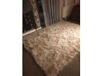 Real goat fur rug or bed blanket