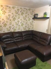 Brown real leather corner sofa and foot stool.
