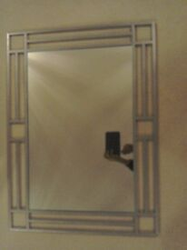 Large mirror with silver metal design frame.