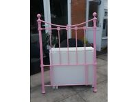 A pink single metal headboard, in excellent condition.