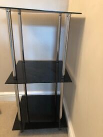 A beautiful 3 shelf glass stand in good condition