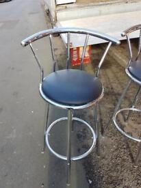 2 chrome bar stools with black leather seats