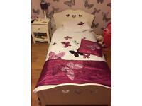 Gorgeous girls single white wooden bed with roll out storage drawer