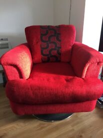 Red revolving large sofa chair in very good condition