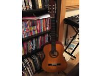 Acoustic guitar, stand, tuner and pick
