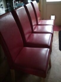 Red faux leather dining chairs