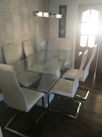 Glass dining table with 6 cream chairs