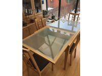 Beautiful glass insert table, it extends to seat 6/8 people. There are 4 matching chairs included .