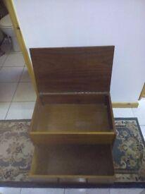 Wooden storage box with drawer.