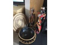 Collection of wooden African statues, bowls and Kenyan woven plate