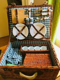 Vintage picnic basket with contents