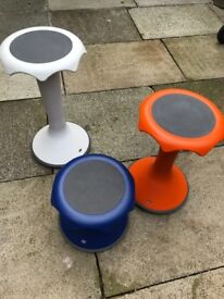 3 ergonomic stools, all different colours and sizes