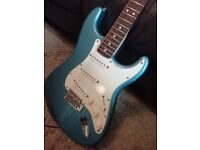 Fender Stratocaster with a rosewood fretboard. Good condition.