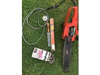 """Electric 14"""" chainsaw, with chain sharpener and spare chain."""