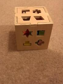 Wooden toy shape sorter