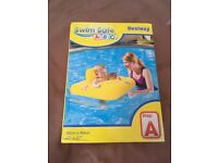 Brand new in box - baby first stage swim seat float
