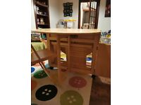 Folding 4 seater table with chair storage underneath
