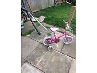 Kids pink bike with stabilisers